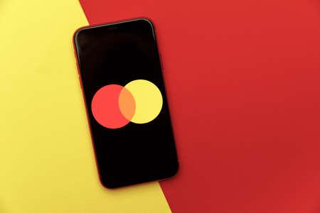 Tula, Russia - January 28, 2020: Mastercard logo on iPhone display
