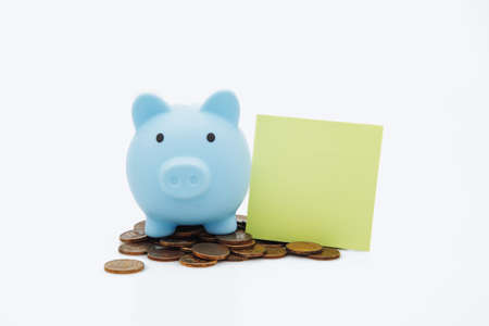 Piggybank, money and green sticky note, place for text, on white background