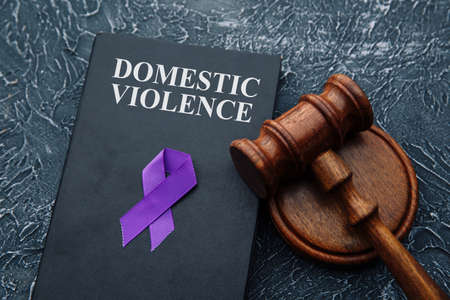Domestic violence law and gavel on grey table 版權商用圖片