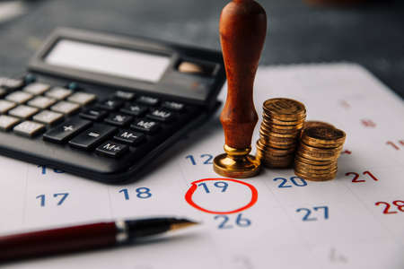 Accountancy Concept. Accountant verify and review monthly saving and payment of Expense to Vendor or supplier for financial Business, Loan, Bookkeeping, Due date, Money