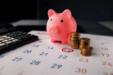 Concept of Debt. By throwing a clean white calendar, specify debt, expenses that will arrive on the last day of the month that must be paid