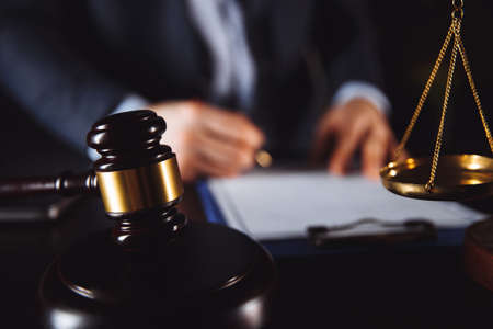 Law concept. Businessman in office working with documents.
