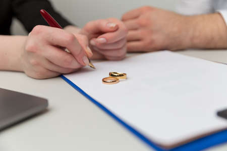 Prenuptial agreement concept. Man and woman signing notary document together. Banque d'images