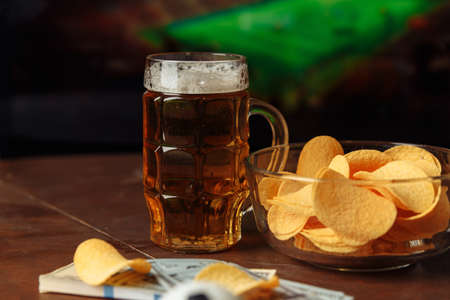 Glass with beer and snack. Soccer fans concept. Watching football at home