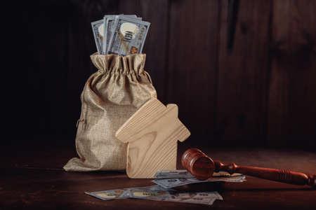 Bag of money, house and gavel