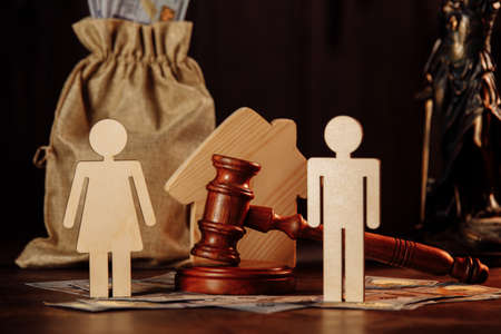 Bag of money, people and the judges hammer. The concept of divorce Фото со стока