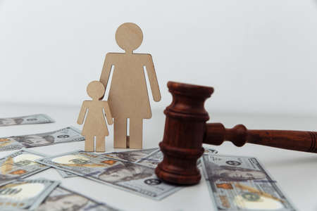 Family law or divorce concept. Mother with daughter and judge gavel