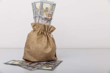 Dollar money bag on a white table