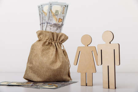 Figures of people with money bag on white background. Family savings concept 版權商用圖片