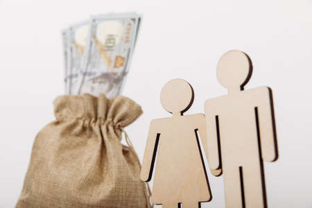 Figures of people with money bag on white background. Family savings concept. Close-up