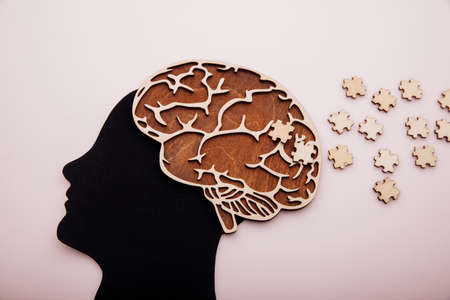 Head of man with brain and puzzle. Alzheimers disease, dementia and mental health concept