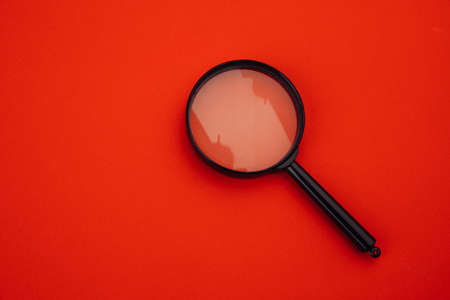 Magnifier on red