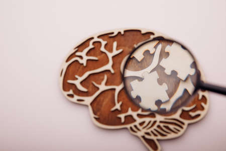 Brain with wooden puzzles. Mental Health and problems with memory concept