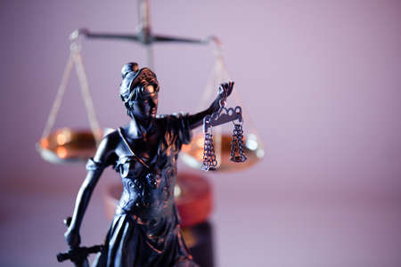 Judgment and law theme. Figure of Lady Justice in notary office