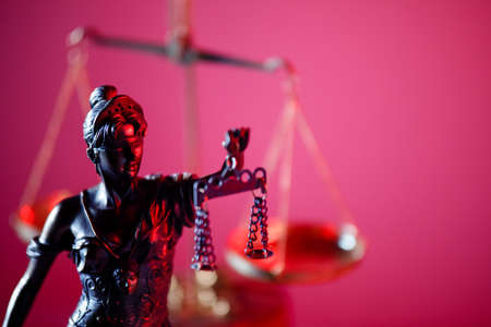 Figure of Lady Justice in notary office close-up. Symbol of justice and law Фото со стока