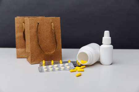 Online shoppng concept. Bags with compounded prescription medications shipped from a mail order pharmacy on a grey background