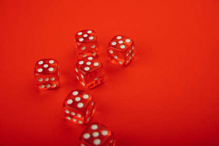 Six red dices with white spots