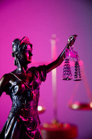 Law and judgment concept. Figure of Lady Justice in purple neon. Vertical image Фото со стока