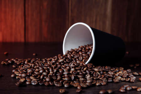 Brown coffee paper cup with aromatic coffee beans