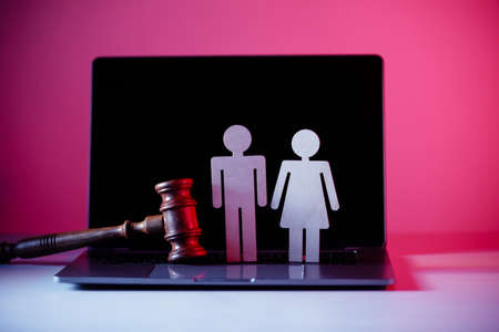 Figure in shape of people and gavel on the table. Family law concept