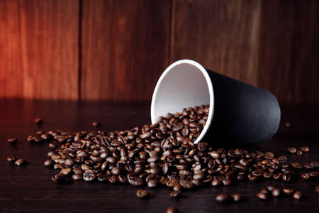 Paper cup with aromatic coffee beans