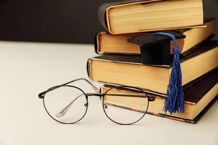 Graduation cap on a table. Graduation concept 版權商用圖片
