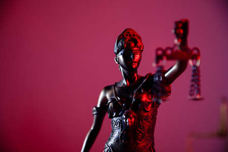 Law and judgment concept. Figure of Lady Justice in notary office close-up