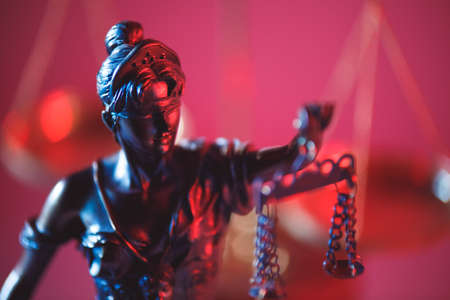 Figure of Lady Justice in notary office close-up in neon. Symbol of justice and law