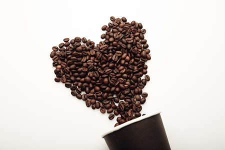 Coffee beans in the form of heart and cup