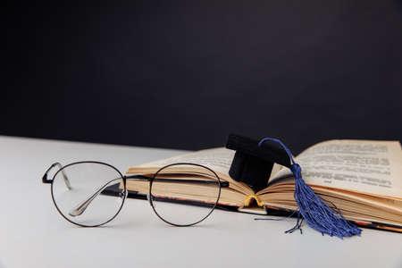 Graduation cap on a table. Education concept