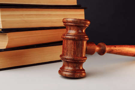 Gavel with law books behind. Law concept