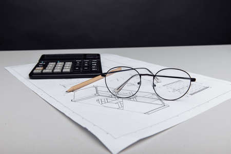 Architectural plan, glasses and calculator. Building cost