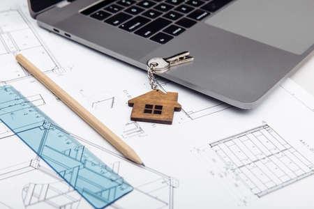 Architectural plan, laptop and house key 版權商用圖片