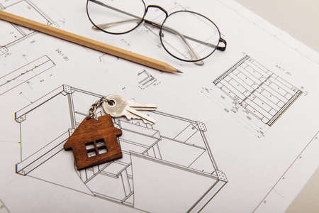 Architectural project, glasses and house key