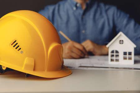 Architect engineer working on blueprint at his office 版權商用圖片