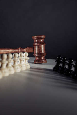Chess pieces and law gavel. Vertical image 版權商用圖片