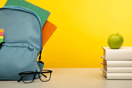 Blue backpack and school stationery on table. School concept 版權商用圖片