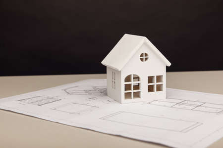 Wooden model of house on drawing