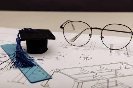 Technical drawings and graduation cap. Engineering education concept 版權商用圖片