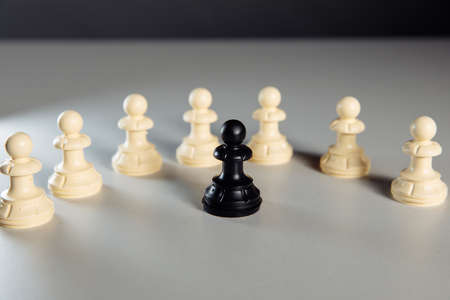 Pawns on the table. Leadership concept