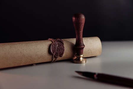 Scroll with wax seal stamp of notary public on a table 版權商用圖片