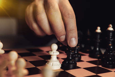Hand playing game of chess. Competition, strategy concept 版權商用圖片