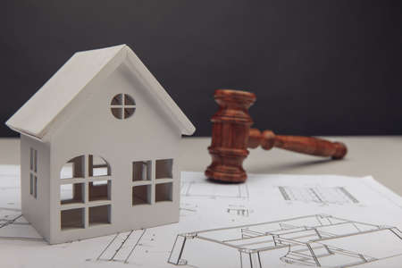 White house, drawing and wooden judges gavel. Law and building concept 版權商用圖片