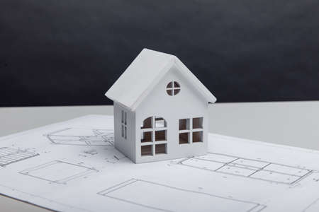 Model of house on drawing. Building and architect concept 版權商用圖片