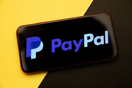 Tula, Russia - April 08, 2021: PayPal logo on iPhone display
