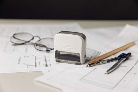 Blueprint with glasses, drawing tools and stamps in engineers office 版權商用圖片