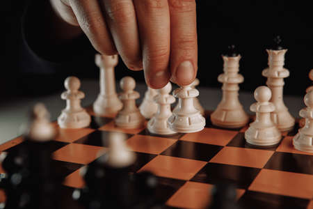 Businessman moves chess pawb figure. Business strategy concept