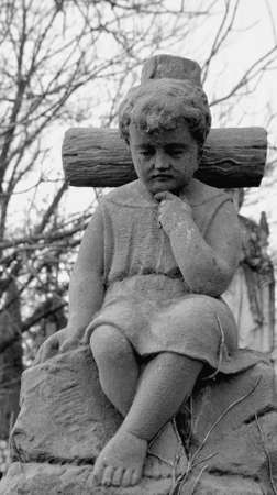 tumulus: The statue of the boy on the cross.