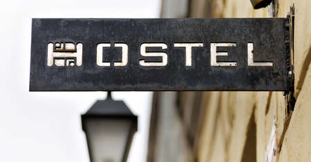 Old signboard hostel Stock Photo