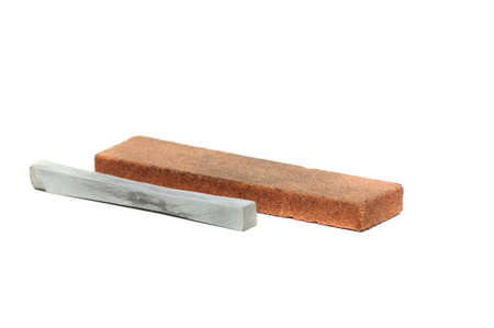 honing: Stone for sharpening a knife isolated on white background Stock Photo